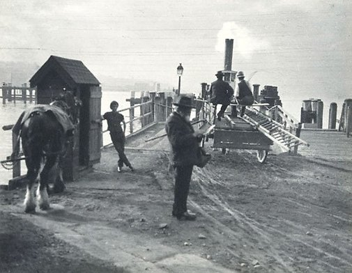 An image of Ticket collector horse punt by Harold Cazneaux