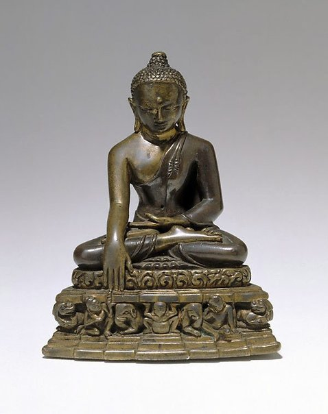 An image of Buddha calling the earth to witness by