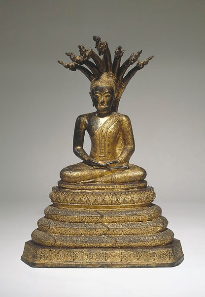 An image of Buddha enthroned under the seven headed naga by
