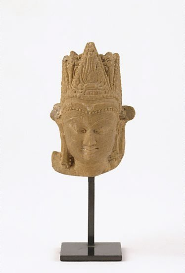 An image of Crowned head of a Buddha by