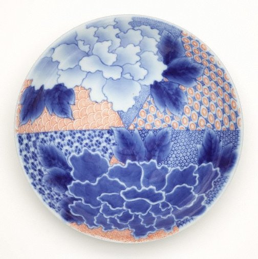 An image of Round dish with peony design and geometric patterns by