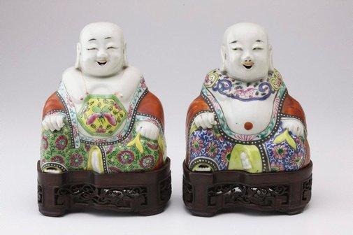 An image of Pair of seated figures twin genii of Mirth and Harmony by