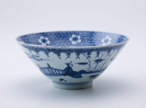 An image of Bowl with bands of white prunus blossoms on a blue sea scroll background; exterior decorated with figures in a landscape by Jingdezhen ware, Transitional ware