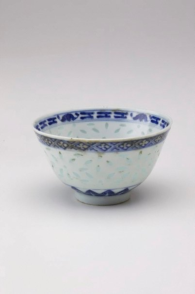 An image of Bowl decorated with 'rice grain' pattern with central medallion of stork and flowers by Jingdezhen ware