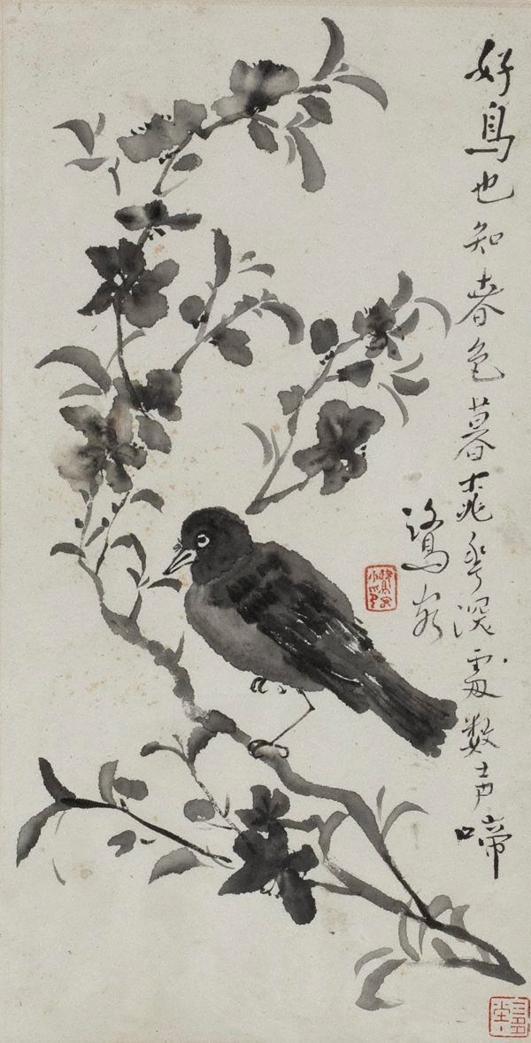 An image of Bird on a flowering branch