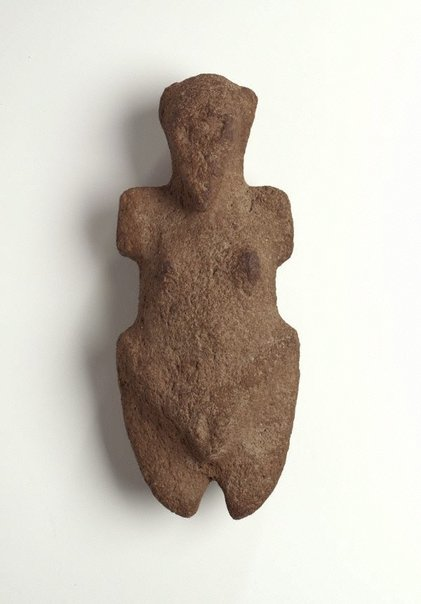 An image of Stone figure by