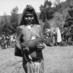 Image: Mendi woman carrying piglet, Mendi, Southern Highland Province, 1963. Photo: Stan Moriarty © Estate of Stanley Gordon Moriarty
