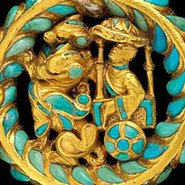 Image:  One of a pair of boot buckles with an image of a carriage drawn by dragons (detail); gold, turquoise, carnelian; 5.5cm d x 1.1cm h. Tillya Tepe, 1st century AD, National Museum of Afghanistan. Credit: Thierry Ollivier