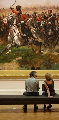 Visitors looking at Rorke's Drift in the Art Gallery of NSW